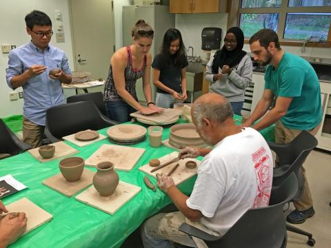 Students learning to replicate archaeological ceramics