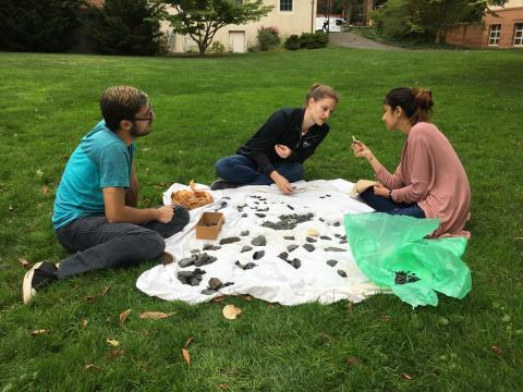 Students selecting materials for an artificial lithic assemblage